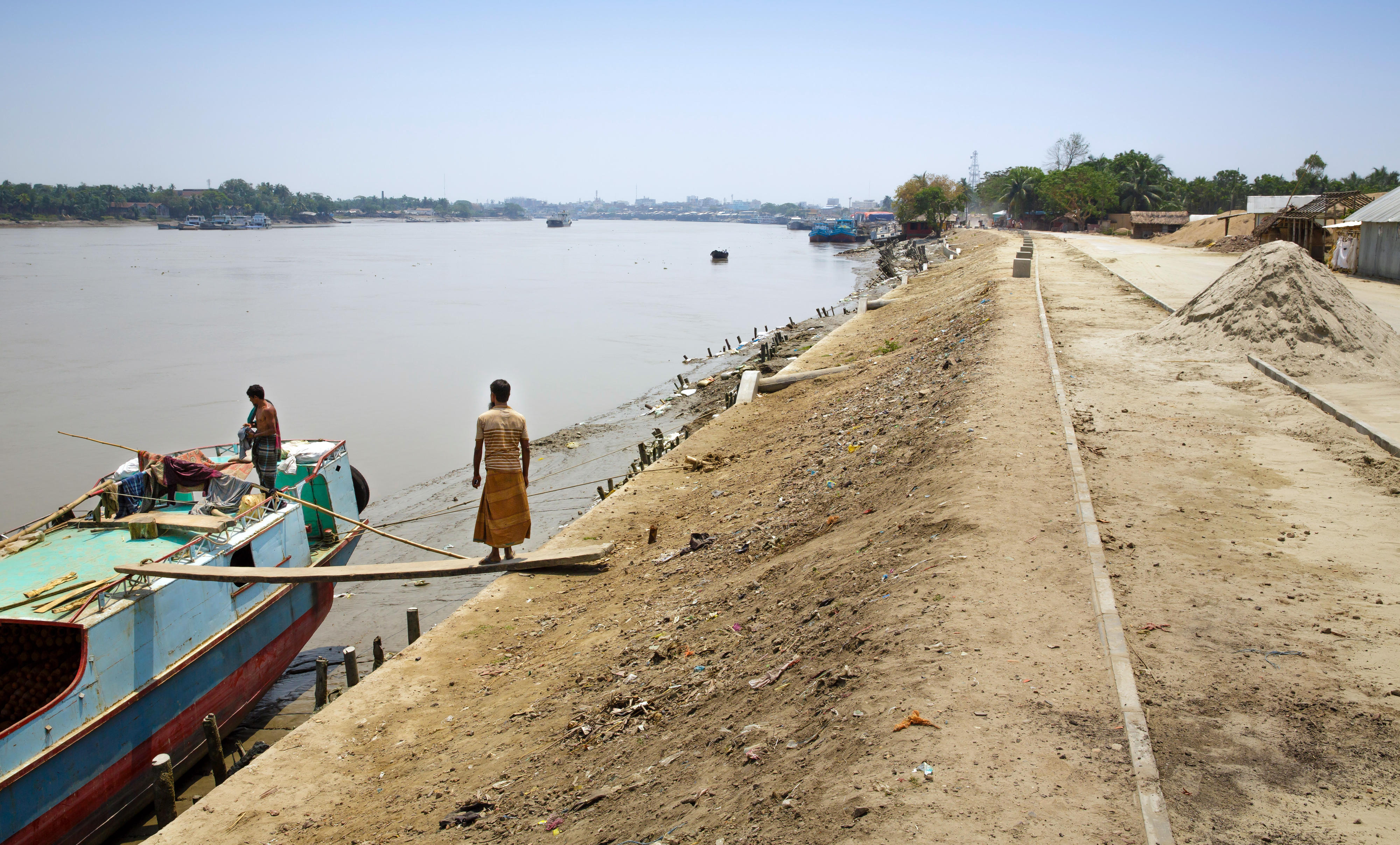 Dam road to protect a residential area at the port of Khulna in Bangladesh