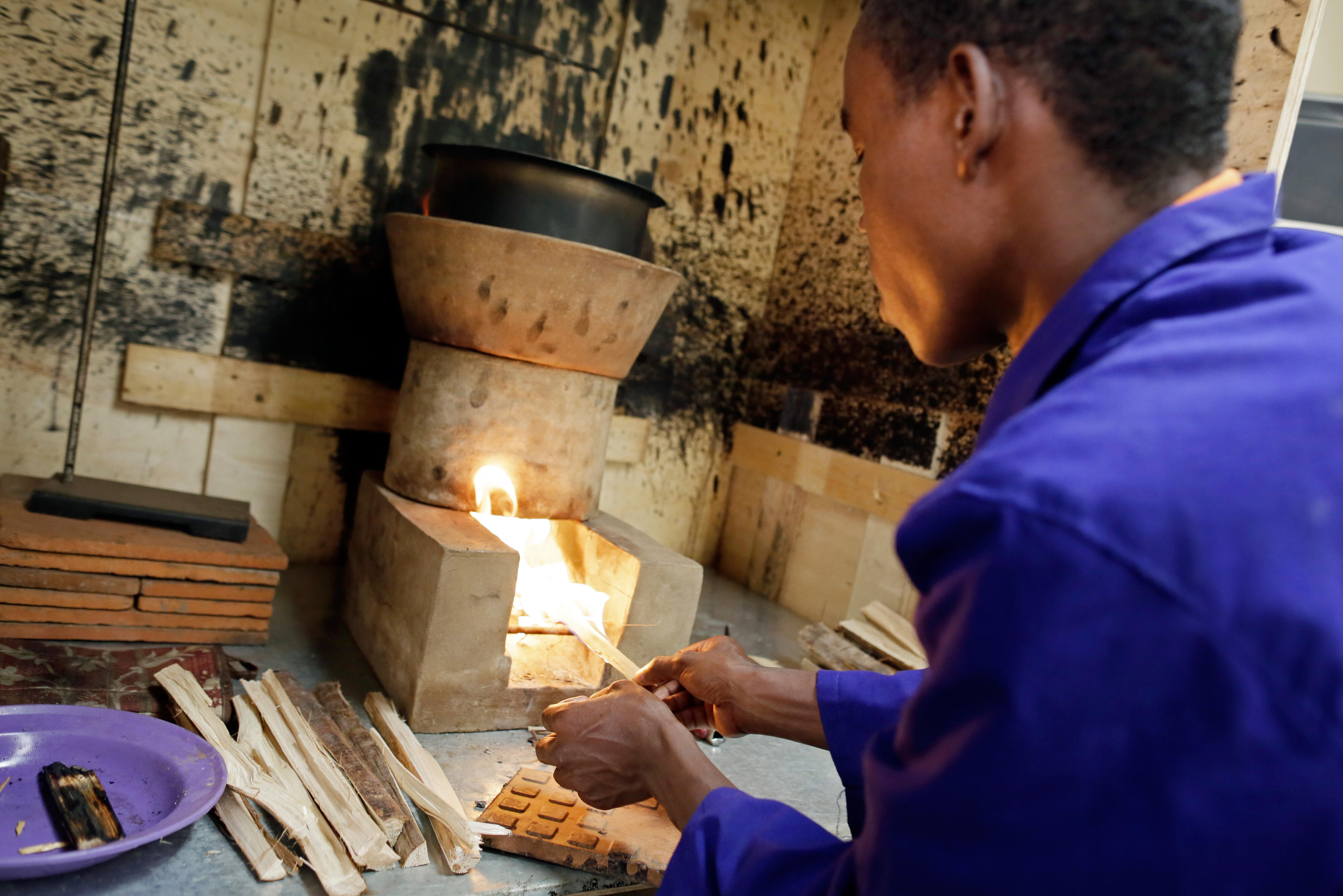Researcher at the Centre of Research in Energy and Energy Conservation at Makerere University in Kampala, Uganda. Here, researchers are testing the energy efficiency of wood-burning stoves.