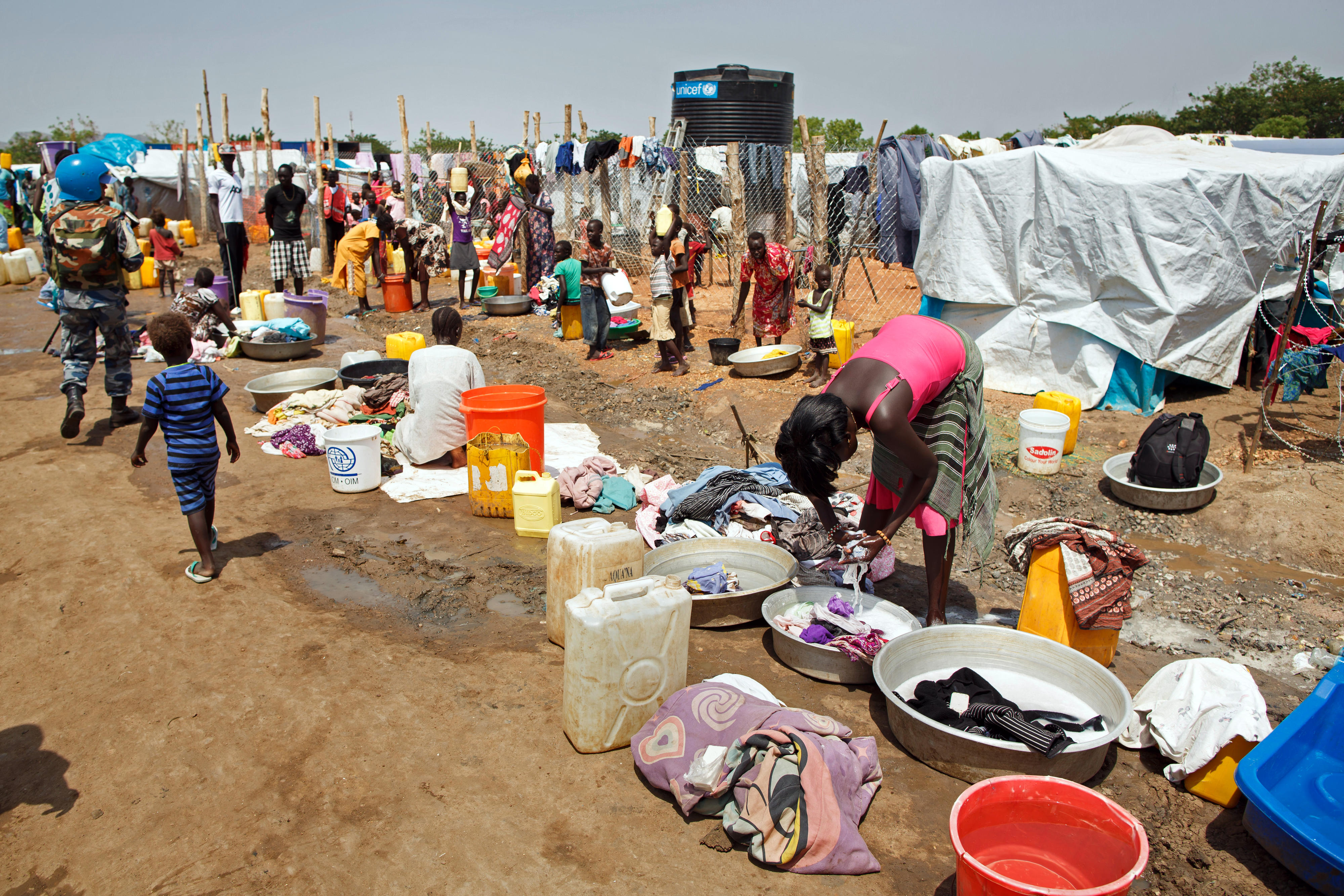 People wash their clothes in an IDP camp in the southern Sudanese capital Juba