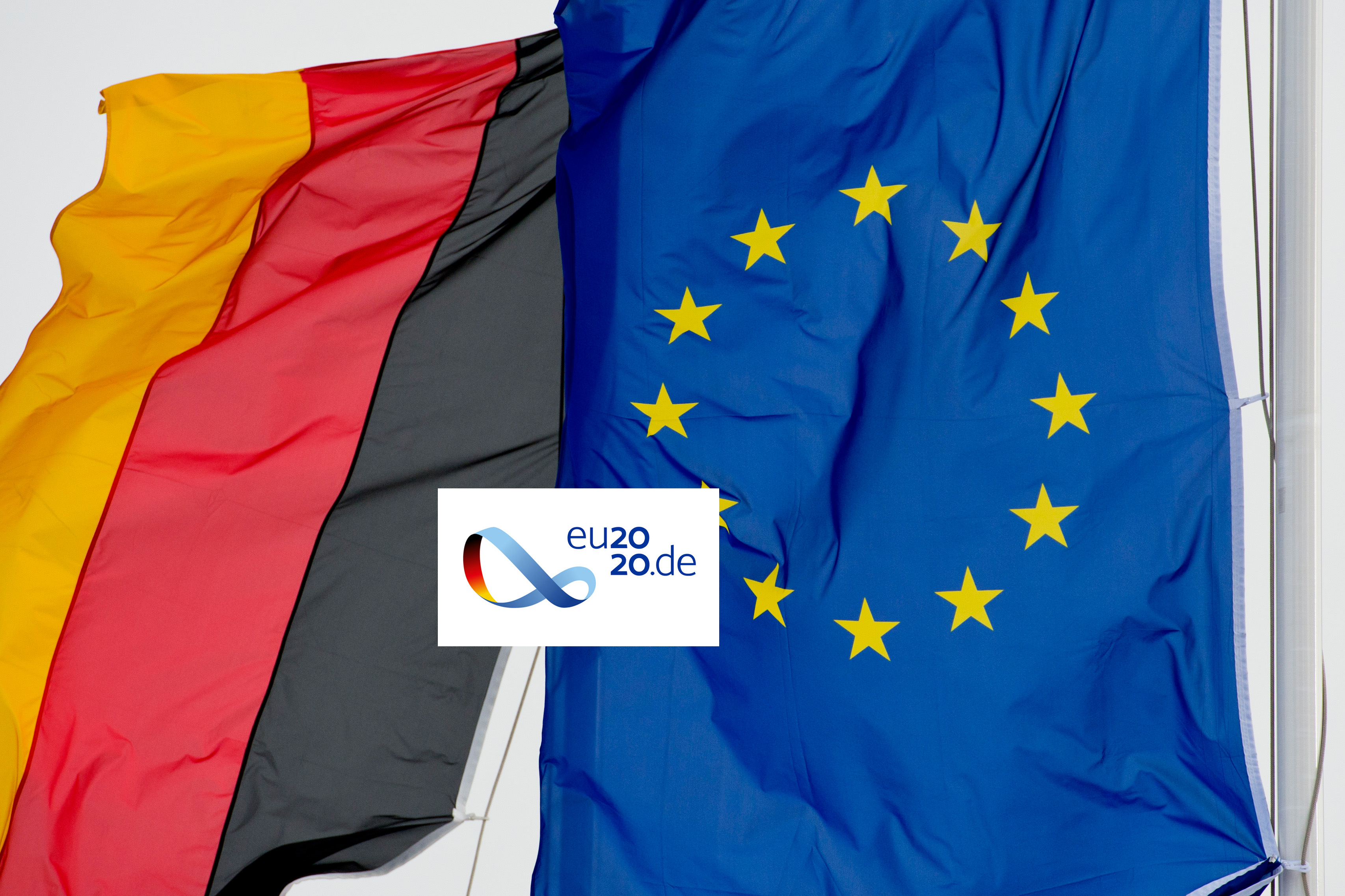 Flag of the Federal Republic of Germany, flag of the European Union and logo of the German EU Council Presidency