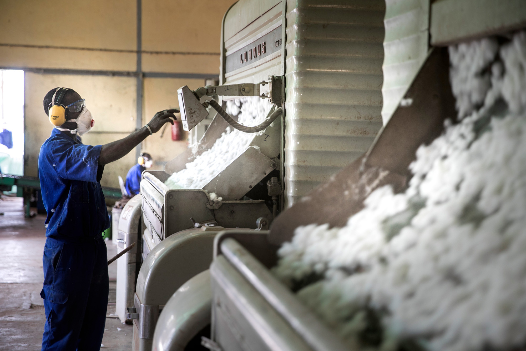 Worker in a cotton ginning plant in Ouagadougou