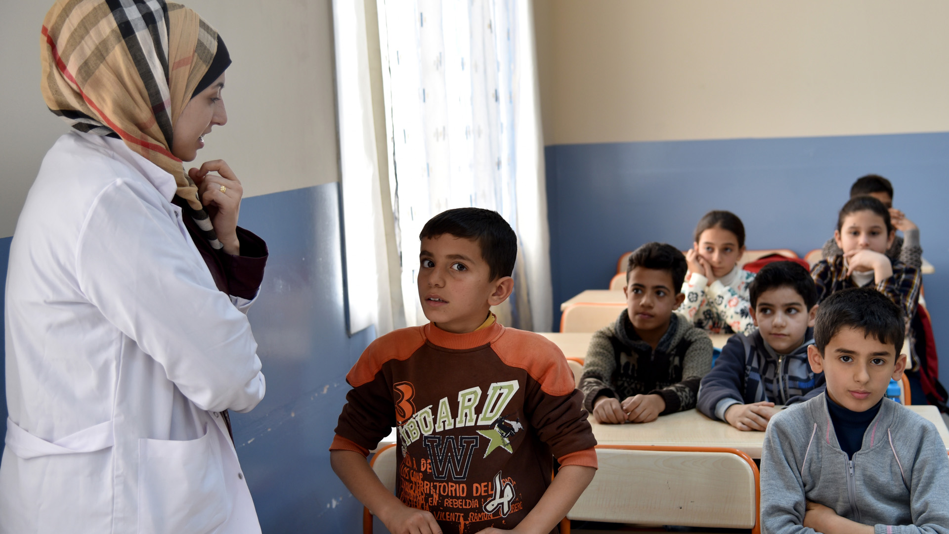 Teacher and students in the UNICEF school in Adana