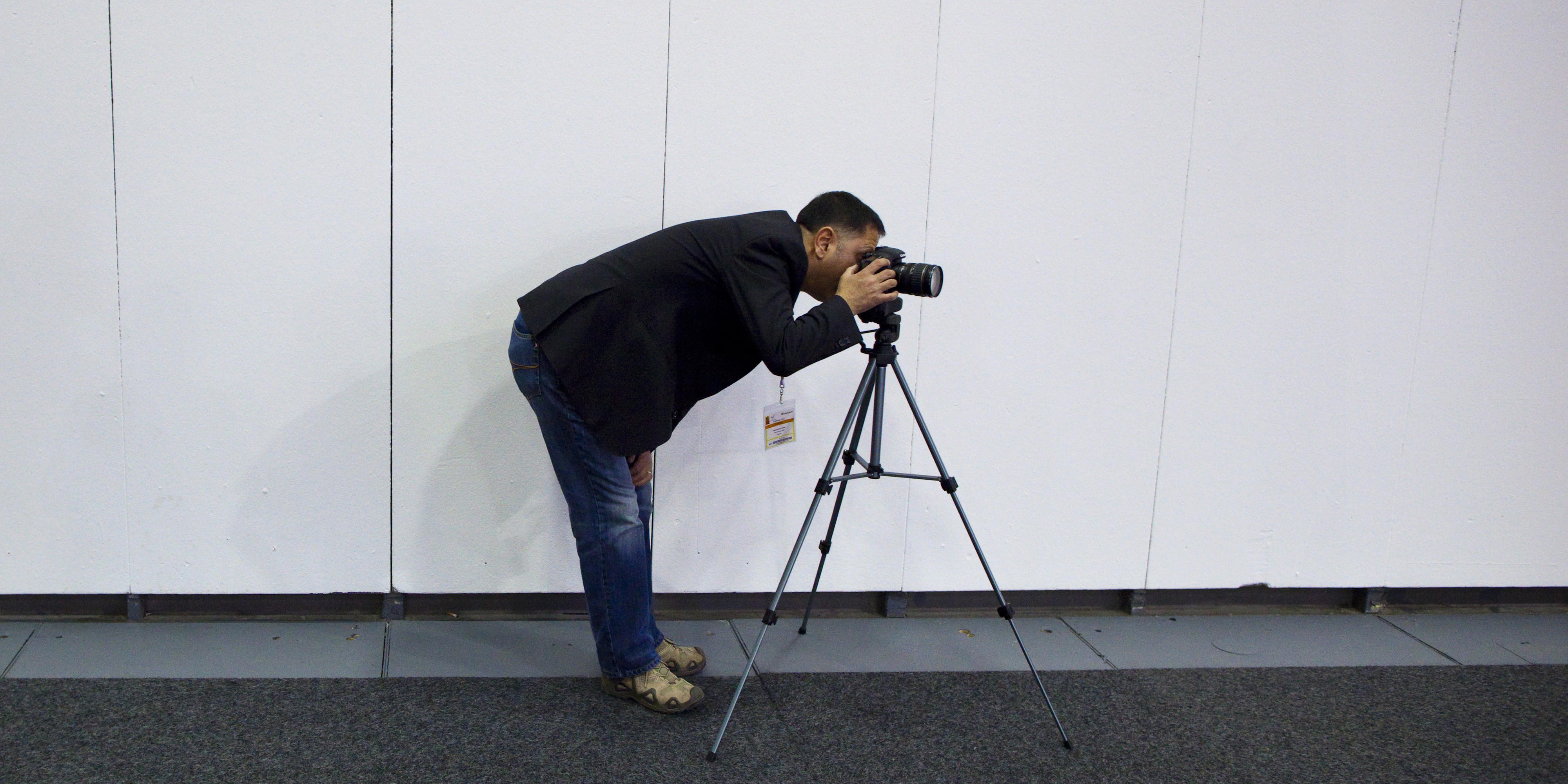 Photographer with camera and tripod